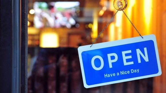 small-business-open-sign-in-window