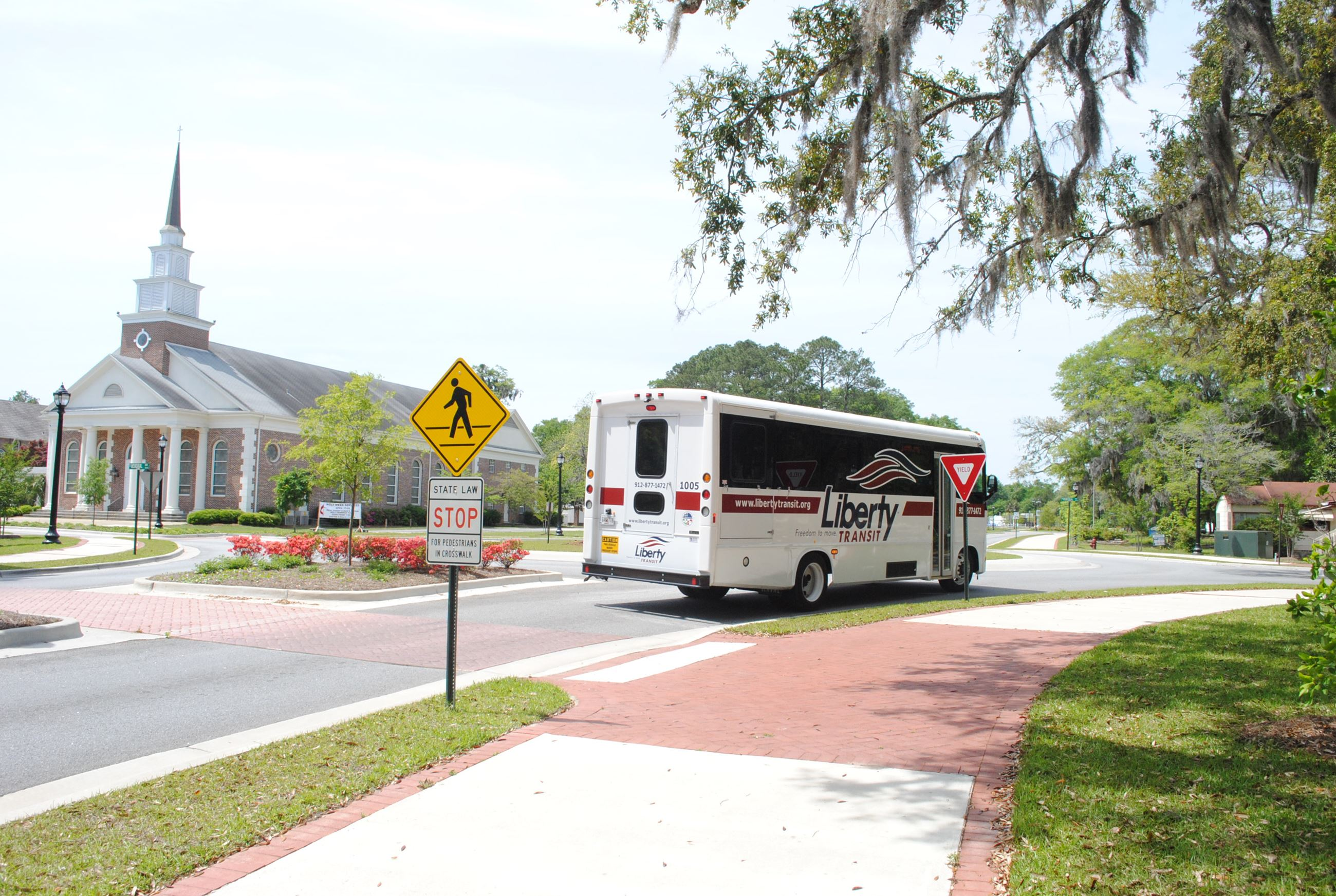 Liberty Transit Bus Moving Through Roundabout